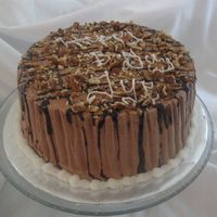 Chocolate , Pecan And Carmel Cake chocolate buttercream w/ ganache drizzle, crushed pecans. filling ganache , carmel and pecans