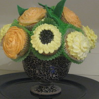 Cupcake Floral Bouquet Vanilla Bean Cupcakes some with Lemon BC icing and others with Orange BC icing.Sunflowers, Begonias and Roses.Thanks for looking . Fun to...