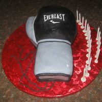 Everlast Boxing Glove Cake vanilla bean cake w/ Strawberry SMBC filling covered in fondant. with gumpaste embellishments.