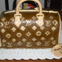 Loius Vuitton Purse This is the first purse cake I attempted. It is two 12 inch square cakes cut in half and stacked like a wedding cake. I carved it into the...