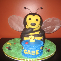 Buzz... Carved 3D bee. I used the idea from the 3D bear pan to move his arm in front of his face, but he is carved from a block of cake. The grass...
