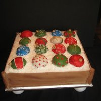 "Holiday Ornaments 16x16 double layer cake with cake ornaments. Fondant ""wood"", butter cream ornaments with dragees and royal icing dusted with..."