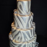 Bling I love this cake. All glam. It's covered in white fondant. I pressed the pattern is as you would to do quilting. then I painted with...
