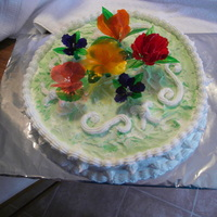 Flower Garden yellow cake with buttercream icing. gelatin flowers and gelatin butterflies. all edible.