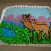 Deer Cake yellow cake, rolled buttercream deer, buttercream icing