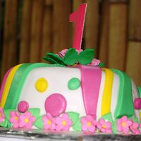 First Birthday Cake  This is the cake that topped my baby's first birthday cupcake tower. I didn't calculate the tower's height, the cake was too...