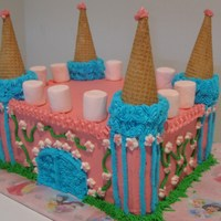 Castle Cake Strawberry flavored cake decorated in all buttercream with ice cream cones for the towers.