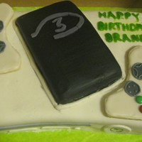 Xbox 360/halo Cake Whtie fondant, sugar cookie controllers. Made for my step son's birthday.