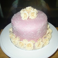 Bride And Groom Cake White cake with bc crumb coat, mauve fondant, ivory roses, white sparkling coarse sugar