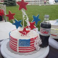 4Th Of July Spice cake with bc icing, stars are from roll out cookie dough (wilton) 3 of the cookies broke on the way and the wind was blowing but all...