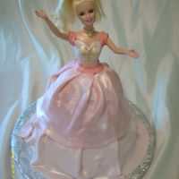 Tennelle's Barbie Cake  This is my first attempt at a Barbie cake. Per the request of my neice. I used a thick layer of buttercream under the fondant dress and...