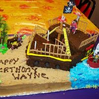 Pirate Ship Pirate Ship cake. The sand is Brown Sugar. All items are edible except for the dowels keeping it together. I either used Pretzels or royal...