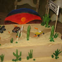 Baja Race   Chocolate cake, chocolate ganache, BC cover with crushed cookies.RI cacti, gum paste accesories.