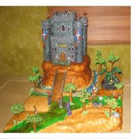 Rune Scape Birthday Cake  This is a cake my son requested for his B-Day, about his favorite internet game pastillage castle, cold porcelain characters, gum paste...