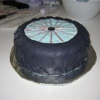 Bike Wheel Cake Bike wheel cake for my dad's birthday. Chocolate cake with black fondant. I then cut out a circle of fondant, exposing the blue...