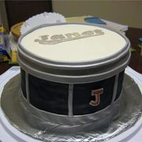 Janet's Drum Cake Made this for a coworker's wife. She is in a marching band and I made it from a picture of her actual snare drum. The logo on top...