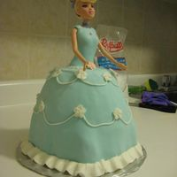 Doll Dress Cake For my girlfriend's coworker's daughter. She supplied the doll and I used a large mixing bowl to bake the cake in. It may have...