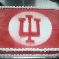 Off To Indiana University this is a 12X18 sheet cake frosted with buttercream. Air brushed with the IU logo and colors.