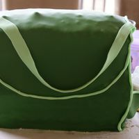 Diaper Bag Cake...what A Disaster! My first attempt at covering a cake in fondant, using dowels to stack a large cake...what a disaster...you can see the dowels on top of the...