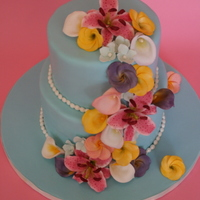Cascade Of Sugar Flowers The flowers include stargazer lily, plumeria and calla lilies