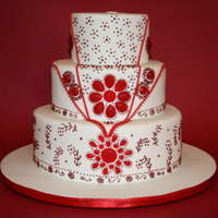 Red Jeweled Indian Style Wedding Cake Piping done in toyal icing. Red jewels made from Isomalt.