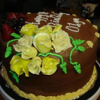 Melissas_Kake_004.jpg Here is the chocolate buttercream cake top & yellow roses