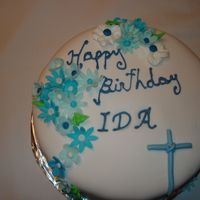 "Happy Birthday Ida She wanted a Blue Velvet Cake, instead of ""Red"" buttercream frosting, covered in fondant with Gumpaste flowers."