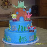 Sponge Bob Made this for a friends little boy. 12 inch round with 8 inch on top and sponge bob's house is made of rice krispie treats.
