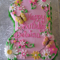 First Birthday Cake Buttercream icing with fondant flowers and chocolate mold butterflies and ladybug