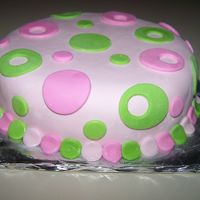 "Pink/green Polk A Dot Sample Cake This was just a sample cake I sold for $15 to someone to show them what I'd be doing for thier daughtrs birthday. 1 8"" cake round..."