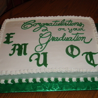 Eastern Michigan Occupational Therapy Graduation White cake, buttercream frosting with the EMU and OT being chocolate molds. Thanks for looking.