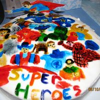 Here Come The Super Heroes!!! I placed a thin layer of gumpaste over a round ten inch cake. I then painted all of my favorite super heroes onto the cake. I also carved...