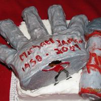 Tribute To Michael Jackson 1958-2009 A chocolate cake that is carved into a hand covered with gray fondant, and I mixed pearl dust and water to give it that shiny look. I did...