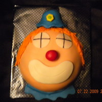 Clown Smash Cake A smash clown cake for a boy's 1st bday party to go along with a popcorn box cake. The cake was marble with raspberry chocolate...