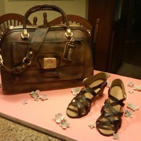 Coach Bag And Shoes This was for a bride who is obsessed with Coach everything! Cake is covered in fondant and all the parts of the purse (buckles, straps,...
