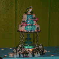 Beach Themed Quinceanara Cake This was for a beach themed Quinceanara event. I was given a picture and duplicated it. The seashells and starfish are made of fondant. All...