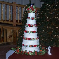 6 Tier Wedding Cake  6 tier wedding tower cake. All cakes were different flavors. Buttercream icing on all cakes. I also did all the flower arrangements for...