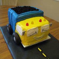 "Dump Truck Cake birthday cake for a 2 year old. Mostly buttercream, with donut wheels and cake crumb ""dirt"". License plate on back had the boy&#..."