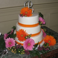 Fresh Flowers This is a wedding cake, with UT orange for the mmf ribbon border. The bride is the mascot for the University of Tennessee.