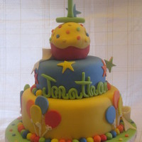 First Birthday Cake This cake was for a little boys first birthday. The parents found a picture they liked and this was my version of it. I think it turned out...