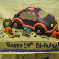 Mechanics Birthday This cake was for my husbands uncle's birthday. I had a hard time coming up with something since his favorite colors are pink and...