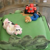 Quad Bike Birthday Cake   Birthday cake for farmers son with new red quad bike for cow herding! Vanilla sponge with strawberry jam fondant covered.