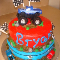 Monster Jam!!   I saw this cake made by whitet4 and I did it with some personal touches!. Covered in BC, flags and rocks are gumpaste.