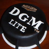 21St Birthday   This cake is modeled off of the MGD bottle cap. The birthday boys initials are DGM and the bottle cap was changed to reflect that.