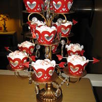 Valentine Cupcakes My 11 year old daughter and I made these. She picked out the decorations. I just wanted to use my new stand, lol.