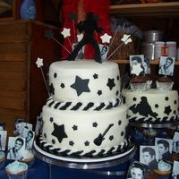 Elvis Lives!!! Cake was done for a 40th birthday party. All buttercream with fondant accents. Small cake on right was chocolate with a white chocolate...