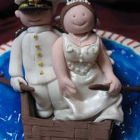 Hokie Cake Closeup A closeup of the bride and groom on my Hokie bridal shower cake. I'm pretty proud of them, especially the groom's Navy uniform....