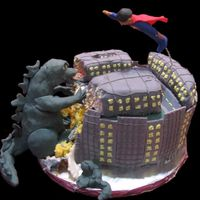 Godzilla Vs Super Jacob  For our friend Jacob's birthday. It's hard to see, but Godzilla is ripping into the cake & the Froot Loop Treat buildings....