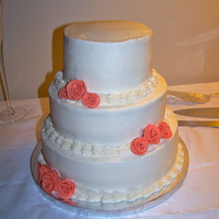 Ivory Wedding Cake My mother-in-law wanted a very simple wedding cake for her marriage this fall. She wanted ivory with copper colored roses. It is a 10 inch...