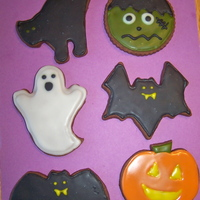Halloween Cookies! I made a variety of Halloween cookies for my daughter's first grade Halloween party. They are chocolate sugar cookies with sugar...